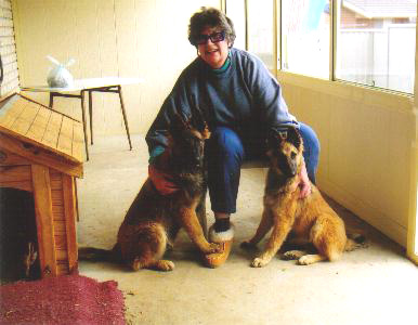 ..Jane sitting with her beautiful 4-legged friends...